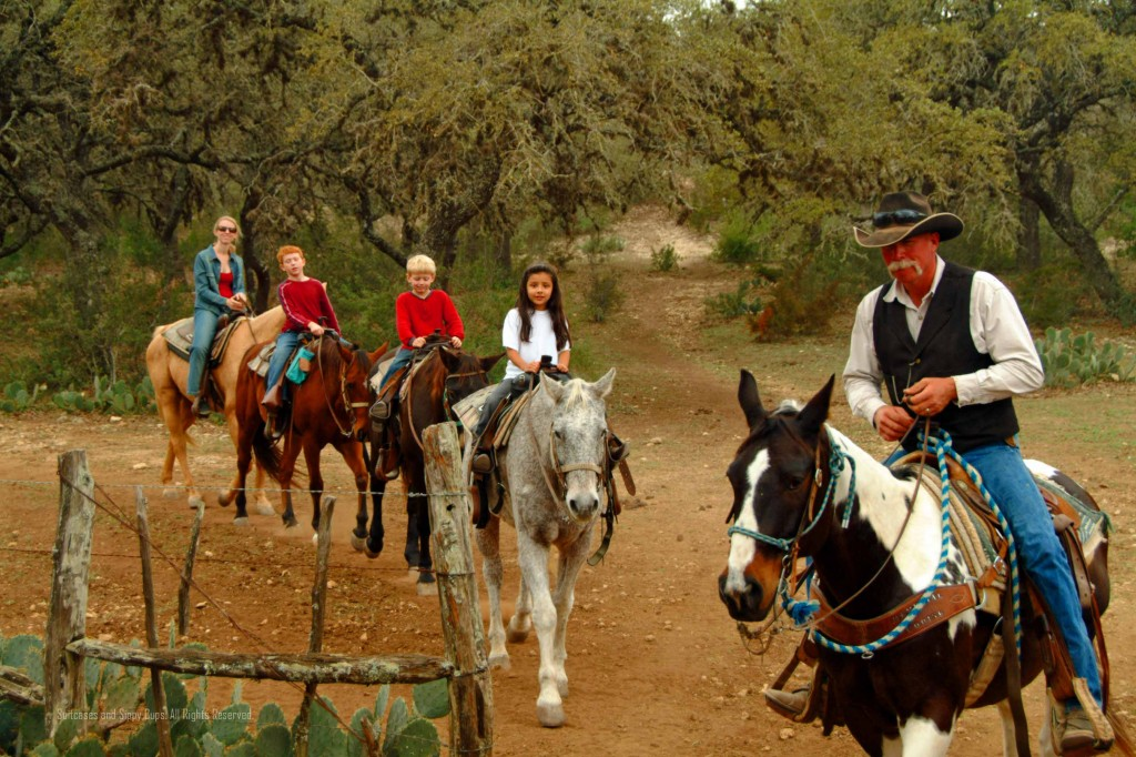 kids on a horse trail