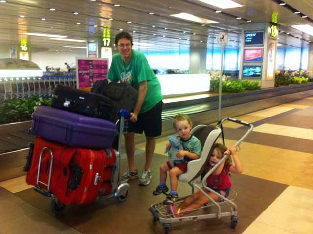 family at the airport with bags