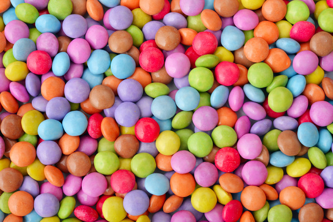 Sweet round multicolor candies spreading  on background