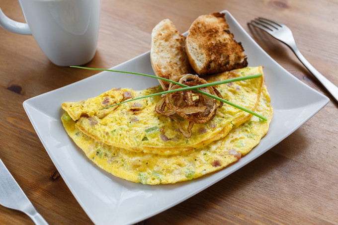 Denver omelet with fried onion on a plate