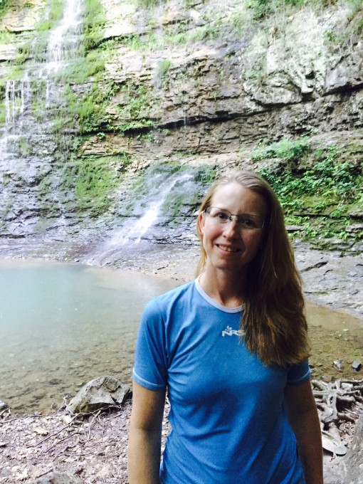 Backpack Taking a Shower in a Waterfall